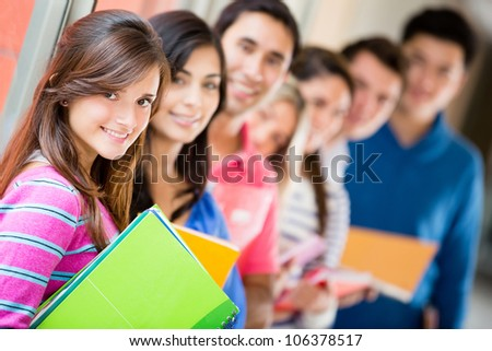 Group of students in a row and smiling