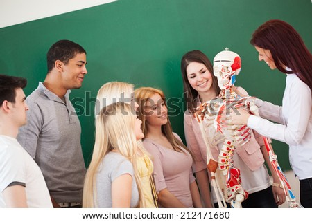 Group of students in an anatomy class with their teacher. - stock photo