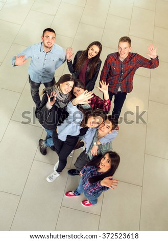 Group of students in the hall of the university, view from above. Selective focus - stock photo