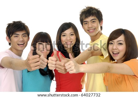 Group of students laughing and giving the thumbs-up sign. - stock photo