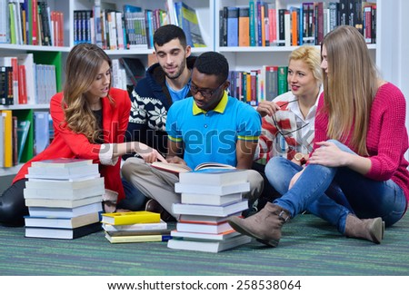 Group of students learning in the library and enjoy it