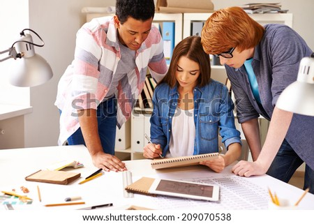Group of students making construction sketch in college