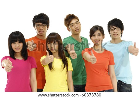 Group of students smiling and doing a thumbs up sign - stock photo