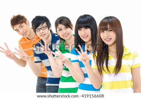 Group of students smiling and doing three finger sign - stock photo