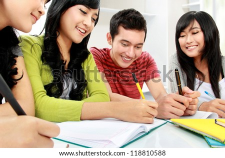 Group of students studying together at home - stock photo