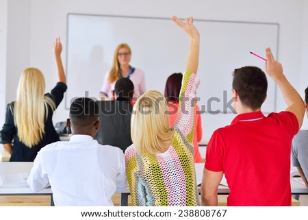 group of students studying together in a classroom