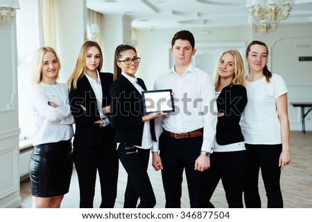 Group of students studying using a laptop - stock photo
