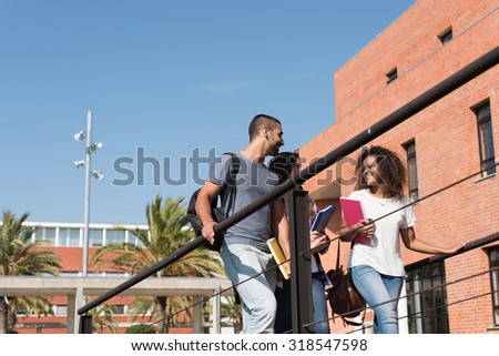 Group of students walking on school campus