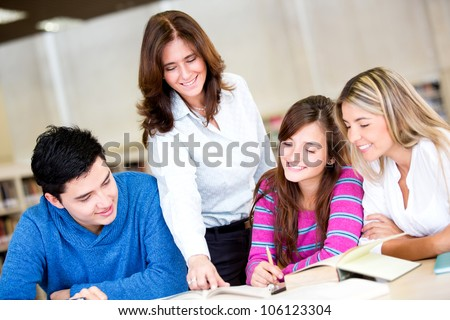 Group of students with an advisor at the university - stock photo