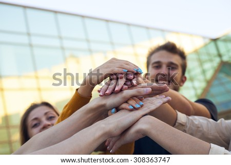 Group of Students with Hands in Stack, Teamwork. Education concept