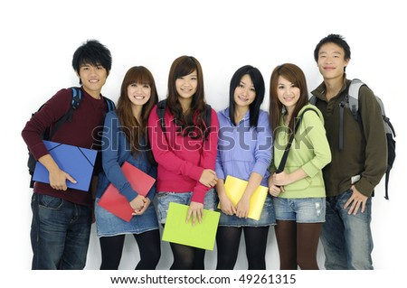 Group Of students with notebooks and paper folders posing