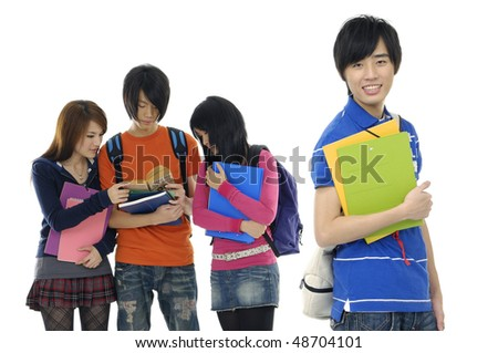 Group Of students with notebooks and paper folders posing--focus on young smile man