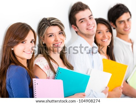 Group of students with notebooks - isolated over a white background