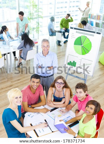 Group of Students with Teacher in the Classroom - stock photo