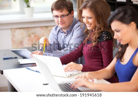 Group of students working in computer lab - stock photo