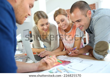 Group of students working on construction project - stock photo