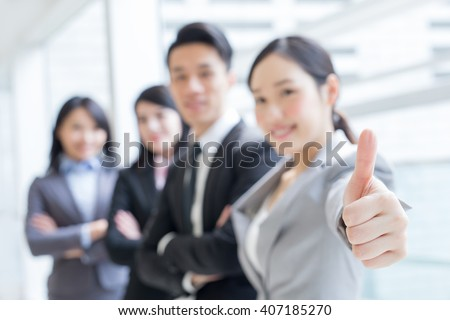 Group of success business people team show thumb up in office, asian, focus on hand