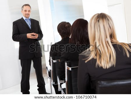 Group of successful business people at the lecture - stock photo