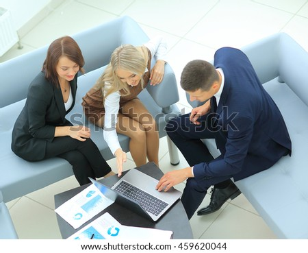 group of successful business people. Discussion  the importa - stock photo