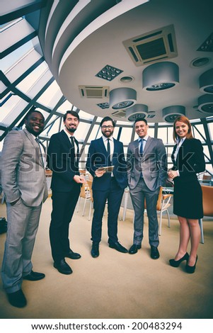 Group of successful business people looking at camera - stock photo