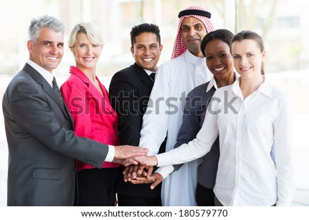 group of successful business team putting their hands together  - stock photo