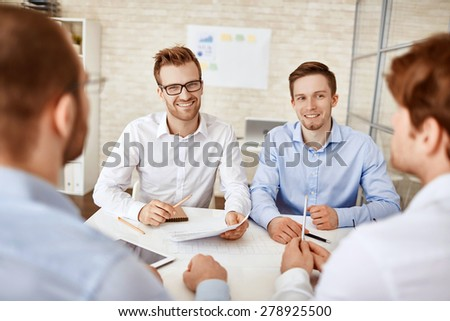 Group of successful businessmen having meeting in office - stock photo