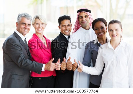group of successful multiracial business team giving thumbs up - stock photo