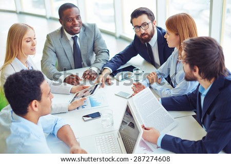 Group of successful professionals planning new project - stock photo
