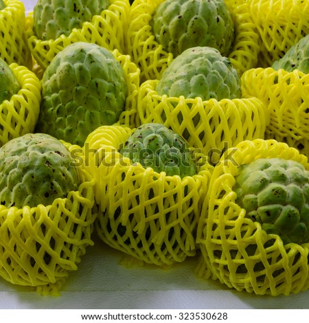 Group of Sugar Apples (custard apple, Annona, sweetsop) in protective wrapper on display at the fruits stall in Bugis Village. They come with vitamin C, thiamine, potassium, and dietary fiber, healthy - stock photo