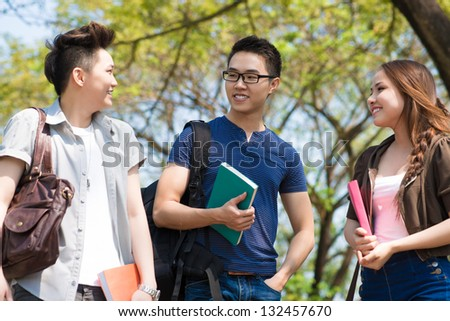 Group of talking students in the park - stock photo