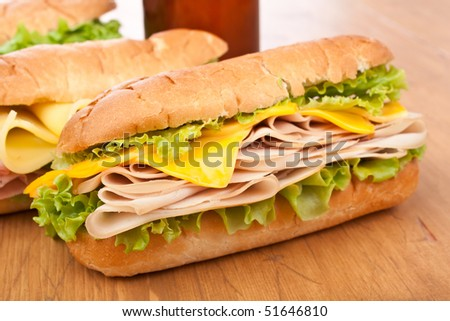 group of tasty ham, salami, turkey and beef sandwiches - stock photo