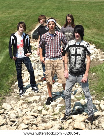 group of teen boys standing outside in rocka