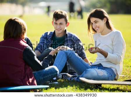 Group of teenage friends chatting and having fun outdoor