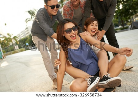 Group of teenage friends fooling about in the street