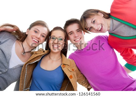 group of teenage friends look down at the camera with bright smiles - stock photo
