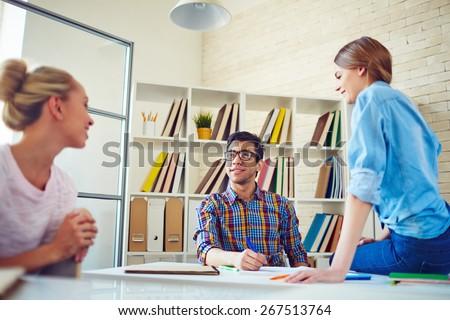 Group of teenage friends talking during break - stock photo