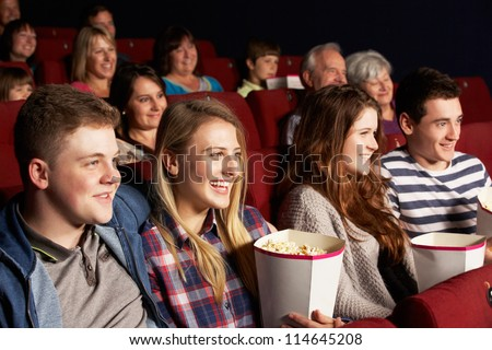 Group Of Teenage Friends Watching Film In Cinema - stock photo