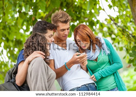 Group of Teenage Friends with Mobile Phone