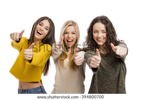 Group of teenage friends with thumbs up - stock photo