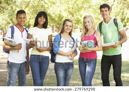 Group Of Teenage Students Standing In Park - stock photo