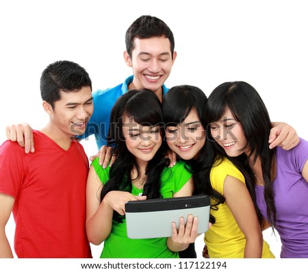 Group of Teenager Friends, one of them hold tablet pc