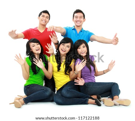 Group of Teenager Friends with colorful shirt sitting together with arm raised isolated on white background