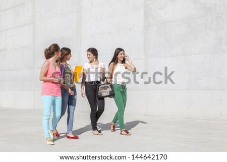 group of teenagers having fun walking on the street - stock photo