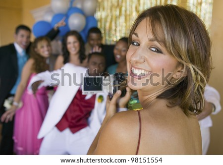 Group of Teenagers Posing for Photo at Prom - stock photo