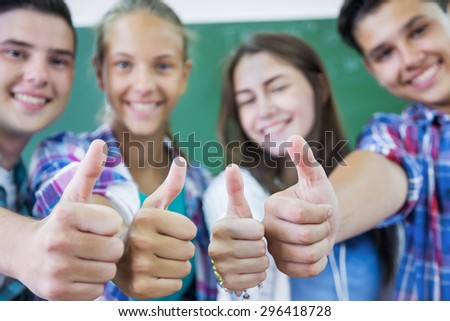 group of teenagers showing gesture OK - stock photo