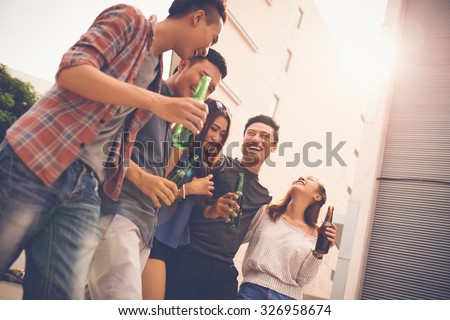 Group of teenagers walking, talking and laughing - stock photo
