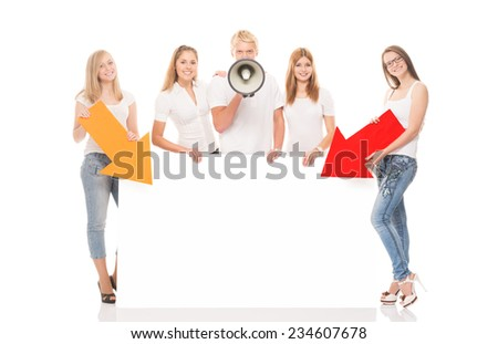 Group of teenagers with a blank, white billboard isolated on white - stock photo