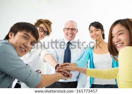 Group of teenagers with his teacher of English