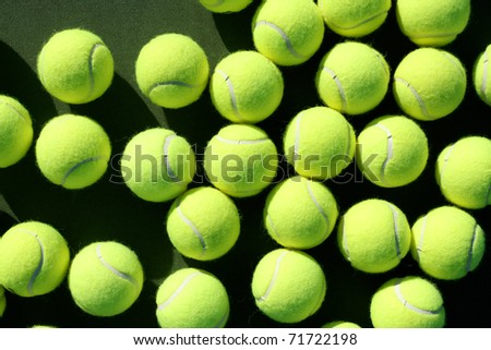 Group of Tennis Balls on the Court - stock photo
