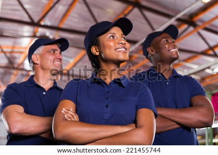 group of textile co-workers looking up - stock photo